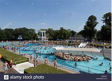crowded outdoor swimming pool of bathing in