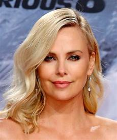 charlize theron medium wavy casual bob hairstyle light blonde hair color