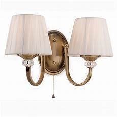 firstlight langham twin arm switched wall light in antique brass