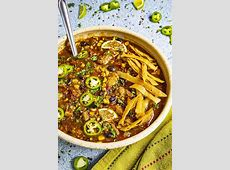 peppers and black beans on a bed of crunchy tortilla strips_image