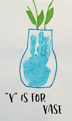 5 hand print activities to do with your 1 year old letter v vase handprint craft for preschoolers
