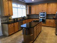 honey maple cabinets paint or not to paint
