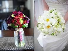 diy wedding flower centerpiece colorful daisies in jar