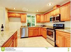 bright kitchen room with light brown cabinets and steel appliances stock image image of