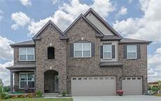 manor house tudor brick monterey taupe hardie siding musket brown shutters rc78 exterior