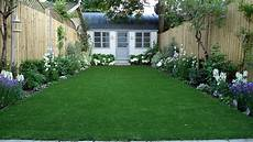 artificial easy grass lawn summer house sandstone paving and white flower planting scheme london