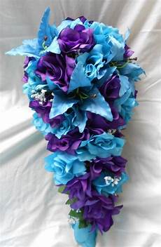purple and turquoise blue cascade wedding bouquet lilies