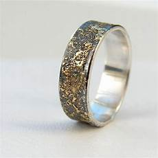 gold chaos rustic men s wedding ring in 18kt gold and