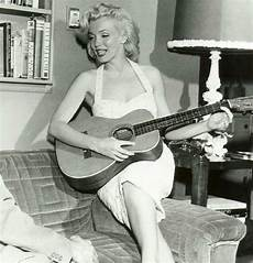 marilyn guitar books and marilyn next to books sings and plays the