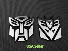 large 3d autobot decepticon transformers emblem badge