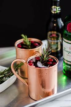 a holiday moscow mule recipe served in a copper mug