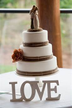 love rustic wedding cake willow tree cake topper photo by prophoto cake by kylie stidwell