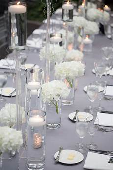 wedding photo by miller and miller of silver and white table top decor wedding