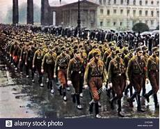sa brownshirts march through the brandenburg gate in