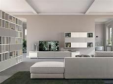 arredare pareti soggiorno soggiorno con libreria living arredamento mobili