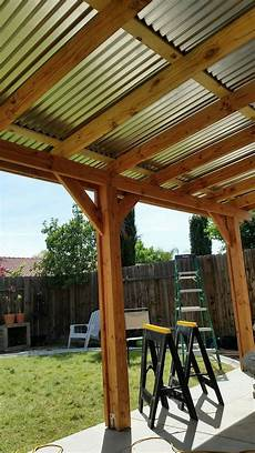 covered patio corrugated metal roof roofingarchitecture roofing architecture pergola patio