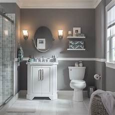 Bathroom Ideas Light Grey by A Pair Of Wall Sconces Perfectly Frame This Bathroom
