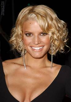jessica simpson with a short curled hairstyle that shows off her neck