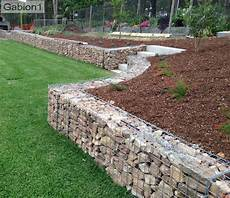 small gabion retaining wall filled with sandstone http