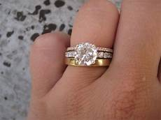 heirloom wedding band mismatched with a diamond wedding band with a solitaire engag mixed