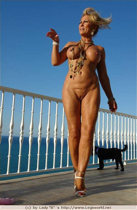 Tall Blonde Mature Poses Fully Naked On The Balcony