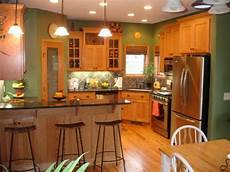honey oak kitchen cabinets with black countertops and green walls best paint colors for