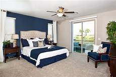 tipping the scale in the darker side for the nautical color scheme we have the master bedroom