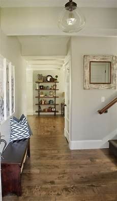 the interior paint color throughout the house is sherwin williams repose gray farmhouse paint