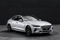 first the 2019 genesis g70 is a grown up kia stinger but that s not a bad thing video