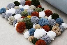 diy yarn pom pom rug sewrella