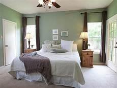 green bedroom with brown window panels hgtv