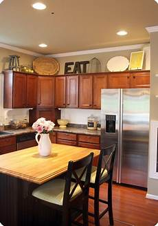 Decorations In Kitchen by How To Decorate Above Kitchen Cabinets From Thrifty Decor