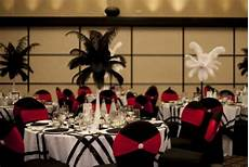 red black and white tables decorated chairs ostrich feathers wedding reception ideas black and