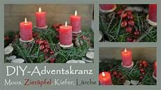 diy adventskranz selber machen in rot i aus moos