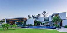 contemporary new delhi villa with amazing courtyard and water priceless touch of modern aesthetics in center court villa
