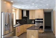 Kitchen Backsplash Ideas With Birch Cabinets by Birch Cabinet Kitchens Corner Cook Top Stainless Steel