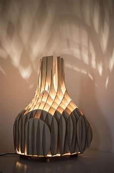 soft glow cast by original plywood lighting unit from