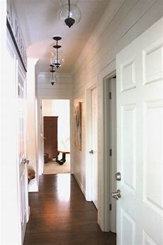 planked wall hallway gets new light fixtures forever