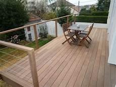 terrasse sur pilotis avec garde corps en bois sud ouest pinte