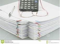 spectacles and pen on pile of overload white paper image of business spectacles