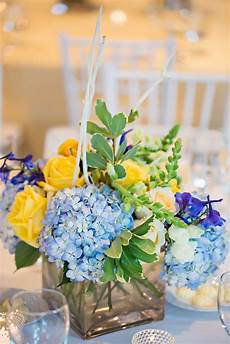 blue and yellow floral centerpieces yellow wedding