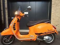 piaggio vespa gts 125cc sport orange 2013