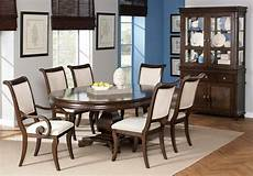 Best Dining Tables by Best Oval Dining Table Beige Scroll Arm Chairs