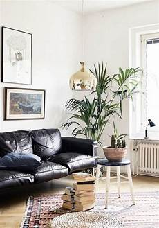 mid century modern style home living room black leather