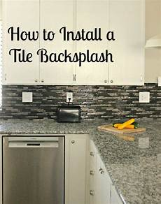 How To Tile Kitchen Backsplash How To Install A Glass Tile Backsplash She Buys He Builds