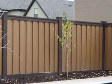 trex seclusions woodland brown fence retaining wall