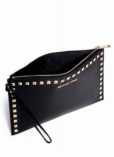lyst michael kors selma studded leather clutch in black