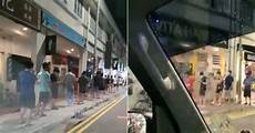 hundreds of men queue up in geylang in drizzle to get hair cut before 11 59pm mothership sg