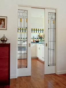 Kitchen Door Transfers by The Design Of These Beautiful Pocketdoors Echo The
