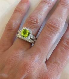 cushion cut peridot and diamond engagement ring and wedding band with milgrain edging and